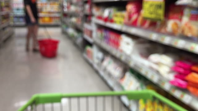 de-focused abstract background ,walking with shopping cart de-focused abstract background , walking with shopping cart department store stock videos & royalty-free footage
