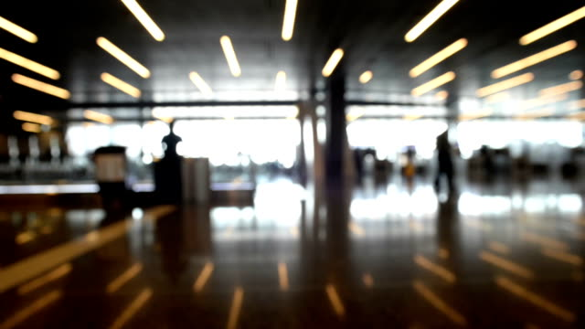 Defocused airport background, Silhouette People walking on the background. video