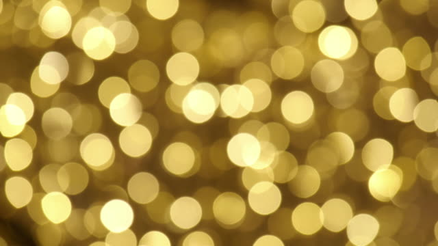 Defocused and blur image of garland of gold led lights