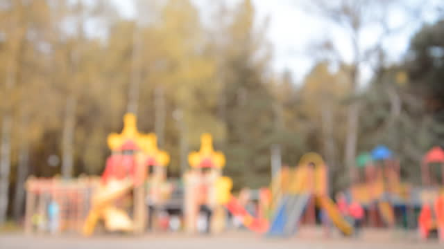 Defocused autumn children playground video