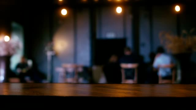 Defocused background - a group of people is sitting in a modern restaurant video
