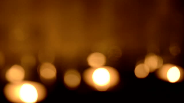 Defocused Candle Background Bokeh blur defocused background of tea light candles glittering candle stock videos & royalty-free footage