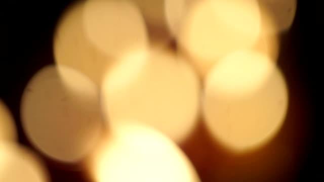 defocused candle lights. - släcka bildbanksvideor och videomaterial från bakom kulisserna