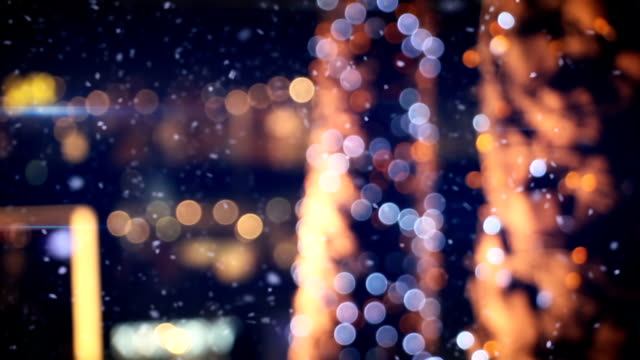 defocused christmas lights in wintry city video