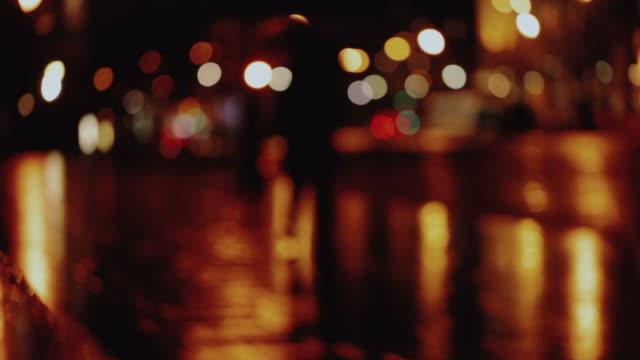 defocused city lights background in paris, france - soft focus video stock e b–roll