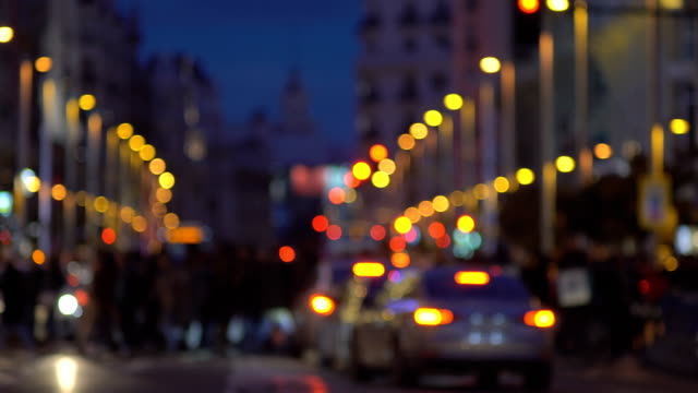 defocused city pedestrian traffic on a busy street/ gran via/ in central madrid - madrid video stock e b–roll