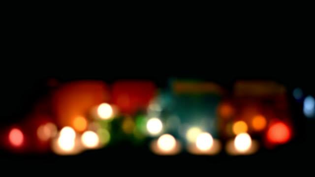 oskärpa färgade lampor på svart bakgrund - ljus på grav bildbanksvideor och videomaterial från bakom kulisserna