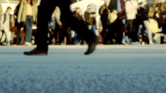 Defocused crowd of people walking in the city video