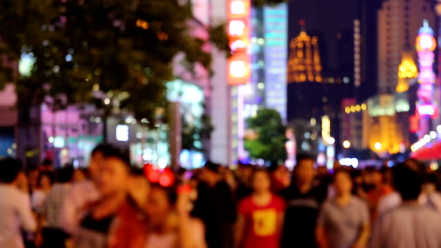 Defocused Crowded Street Crowded street in the city center of Shanghai, China. Nanjing Road is Shanghai's busiest shopping street. Crowds of tourists are going sightseeing and enjoying the night view on China's National Day.  shanghai stock videos & royalty-free footage