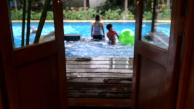 Defocused Family Having Fun In Swimming Pool video
