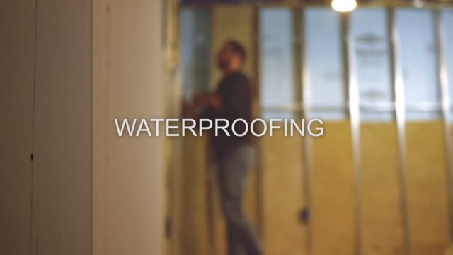 defocused finishing basement contractor text series - waterproofing - basement stock videos & royalty-free footage