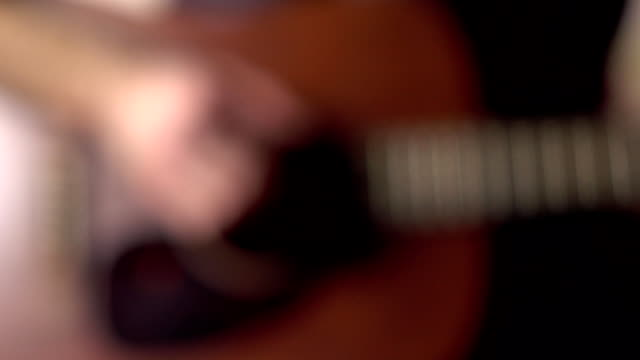 Defocused guitar player's hand touching strings. Music performance. FullHD video video