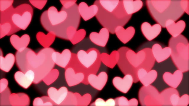 Defocused heart shaped candle lights. video