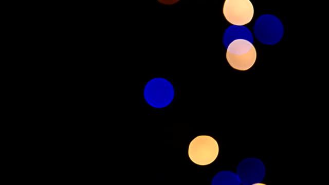Defocused lights isolated on black (Loopable) video