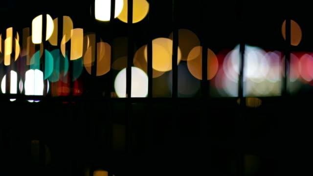 oskärpa lampor, passerande bilar, natt - wheel black background bildbanksvideor och videomaterial från bakom kulisserna