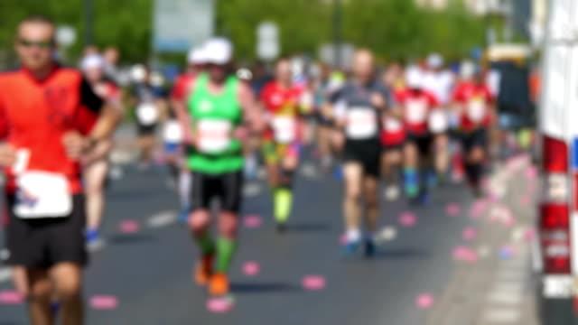 Defocused marathon runners in 4K slow motion 60fps