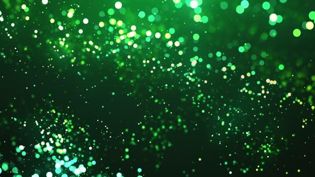 vídeos de stock, filmes e b-roll de partículas desfocadas em câmera lenta - verde - animação de fundo abstrata - loopable - esmeralda