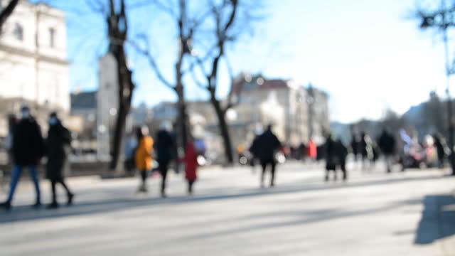 Defocused people on the street walking video