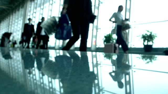 defocused people walking in airport - аэровокзал стоковые видео и кадры b-roll
