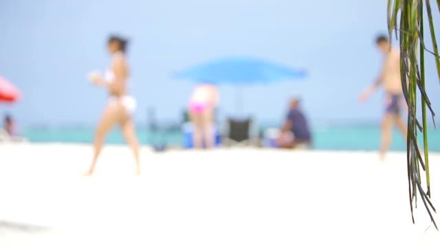 HD Defocused people walking on white sand Caribbean beach video