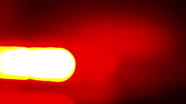 Defocused police red blue emergency lights flashing in the dark