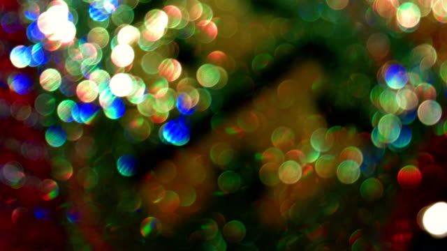 Defocused rotating lights abstract background video