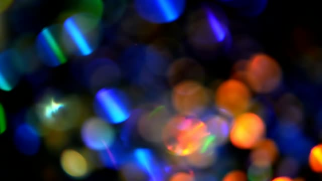 Defocused shimmering multicolored glitter confetti, black background. Holiday abstract festive bokeh light spots. Defocused shimmering multicolored glitter confetti, black background. Party, magic, imagination. Rainbow colors, sparkle circles. Holiday abstract festive texture of shiny blurred bokeh light spots. sequin stock videos & royalty-free footage