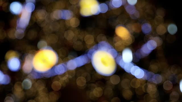 Defocused twinkling Christmas lights on tree video