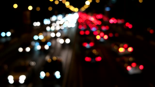 defocused view of traffic jam / beijing, china - città diffusa video stock e b–roll