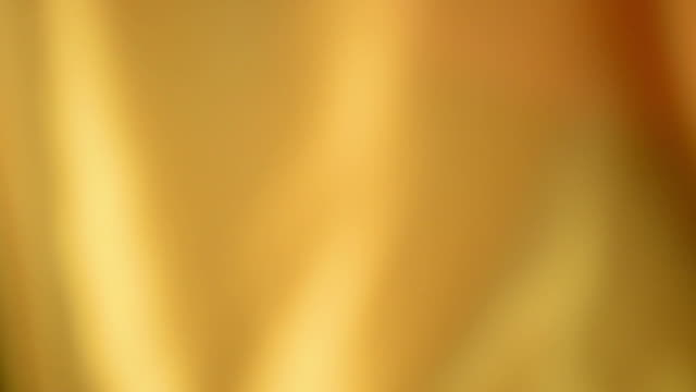 Defocused waving yellow satin video