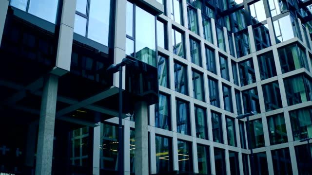 360 degree panoramic shot of surrounding modern glass facade business center. FullHD video video