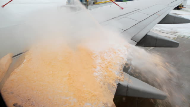 De-icing the plane. video