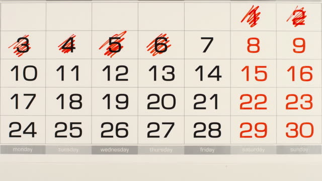 vídeos de stock e filmes b-roll de top view: deleting (red marker) out a numbers in a calendar - stop motion - mês