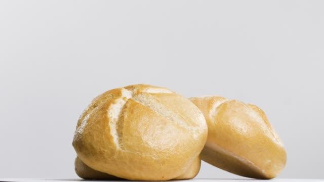 Delicios homemade bread A shot of fresh homemade bread bun bread stock videos & royalty-free footage