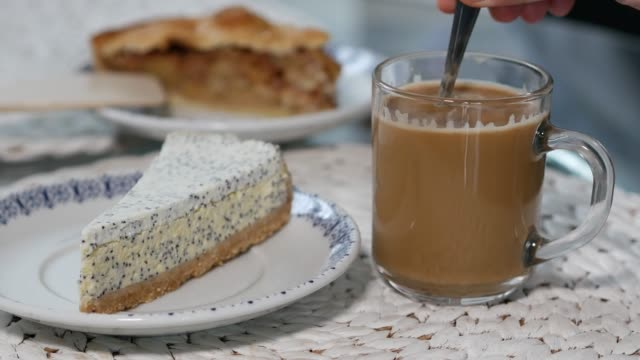 Delicious cheese cheesecake with coffee cup. video