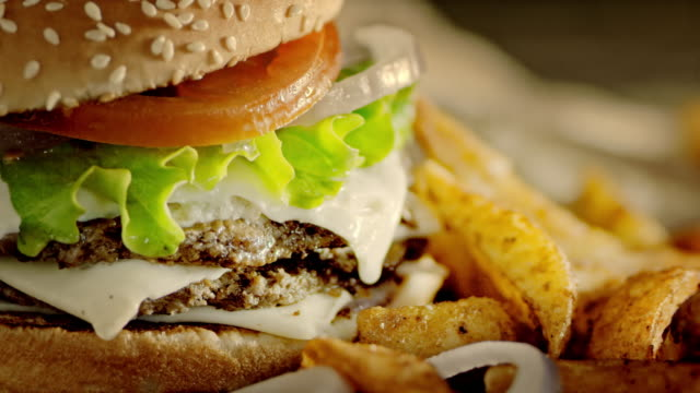 slo mo ds delicious double hamburger and crispy potato wedges - burgers stock videos and b-roll footage