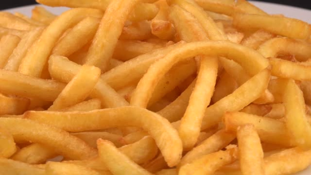 Delicious french fries on a plate on turntable Delicious french fries on a plate on turntable french fries stock videos & royalty-free footage