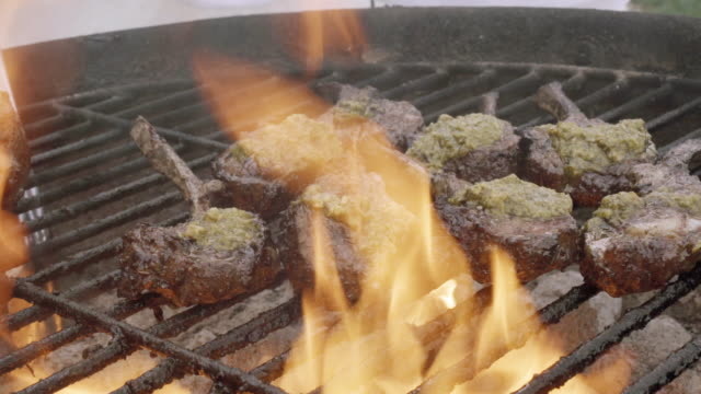 Delicious Gourmet Grilled French Lamb Chops On A Charcoal Grill With Flames