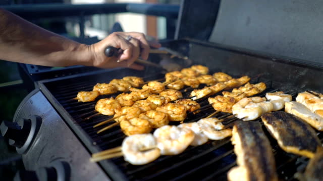 Delicious grilled shrimp Delicious fresh grilled prawns are prepared skewer stock videos & royalty-free footage