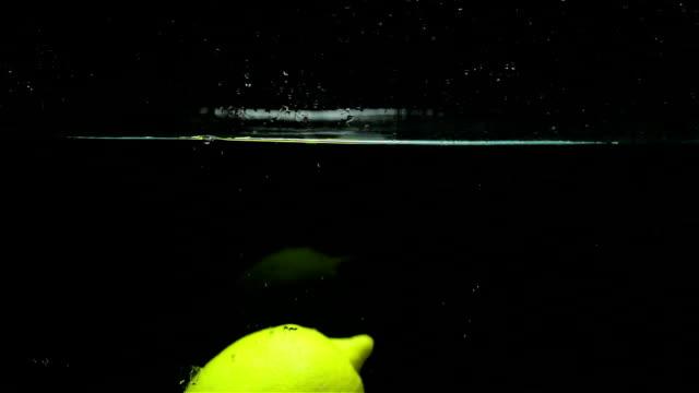 Delicious juicy lemon on a black background video