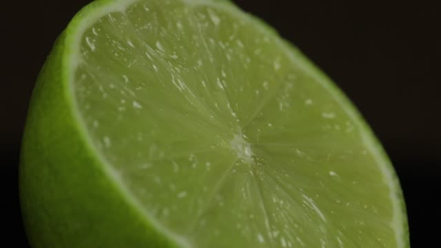 delicious lime cut for squeezing fresh juice. lime half - сжимать стоковые видео и кадры b-roll