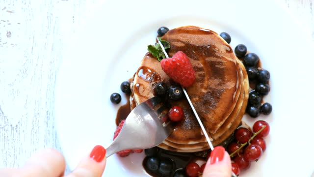 Delicious pancakes on wooden table with fruits video