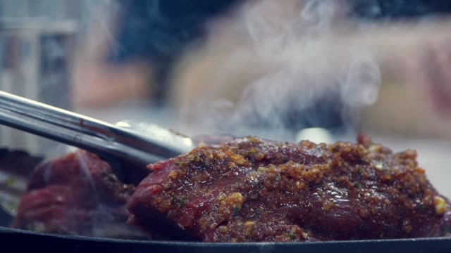 A delicious piece of meat with the smoke. Culinary Arts video