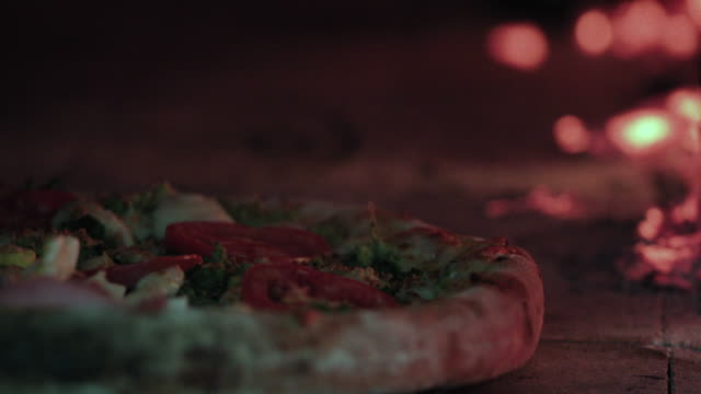 delicious pizza being roasted in traditional wood oven video