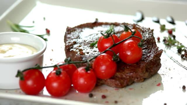Delicious ribeye steak close up. video