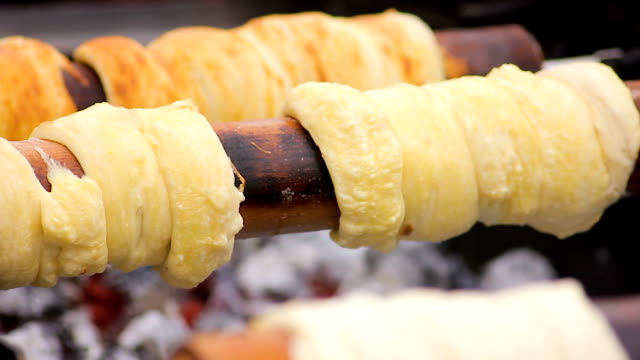 Delicious sweets cooking at street food festival, flour products, bakery video