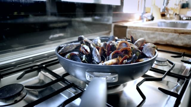 Delicious tasty steaming mussels on pan video