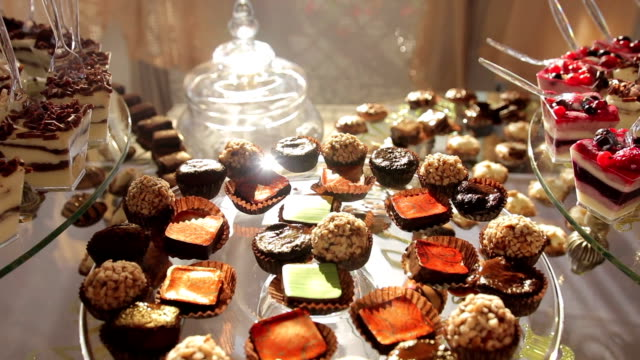 delicious wedding reception candy dessert table - desserts stock videos and b-roll footage