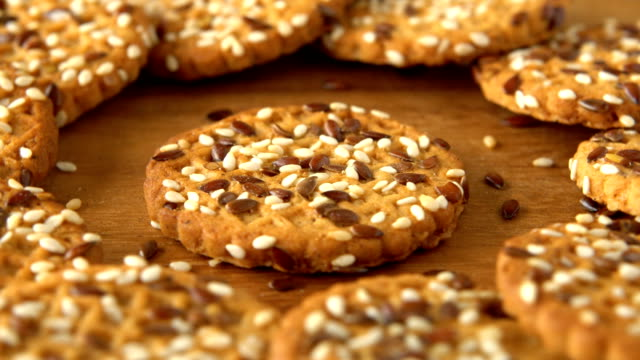 delicious yummy freshly baked homemade cookies rotating on a wooden board. looped - sesamo video stock e b–roll