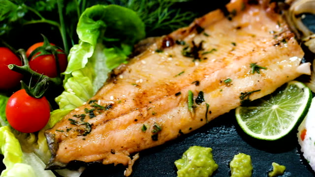 deliciously fried trout  fillet with rice and greens - trout video stock e b–roll